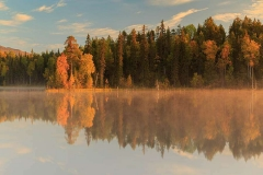Autumn landscape, the dawn on the lake Paanajarvi