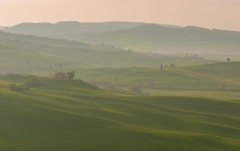Val d'Orcia, a valley covered in fog