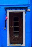 Burano, Venezia, blue wall and door with umbrella