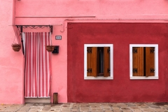 Burano, Venezia, house with pink wall and pink door